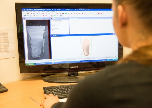 Young female textiles technician creating bespoke insoles for people with medical conditions
