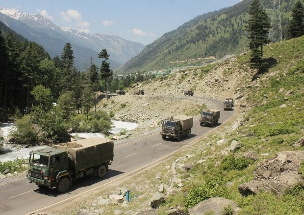 An Indian army convoy of trucks moving along the Srinagar-Ladakh highway.