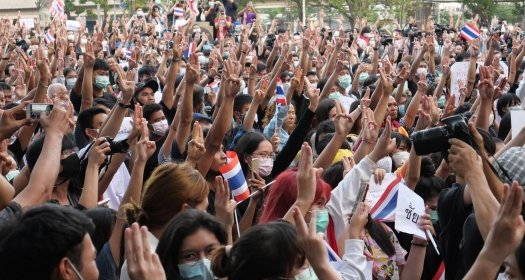 Protestors showing a three finger salute at a university in Bangkok, Thailand.
