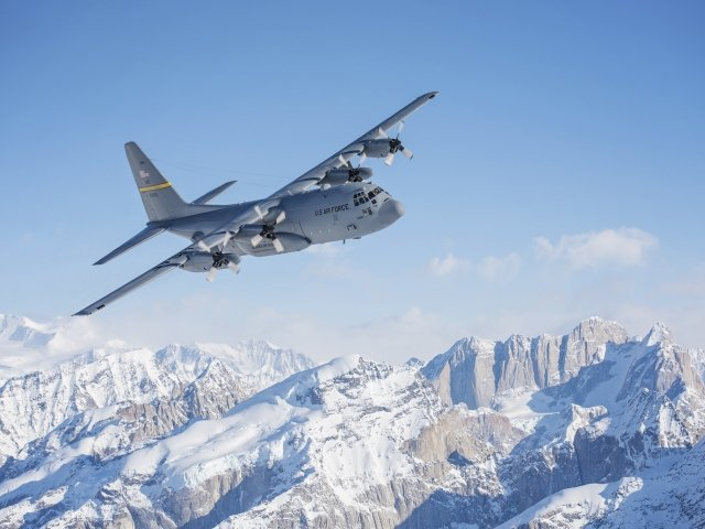 A C-130 Hercules, from Alaska Air National Guard's 144th Airlift Squadron, flies over Denali National Park and Preserve, Alaska, March 4, 2017.
