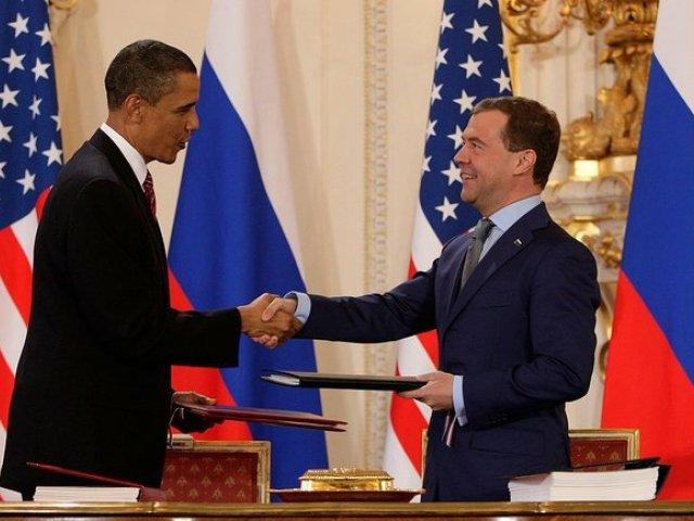 President Barack Obama and Russian President Dmitry Medvedev sign the Prague Treaty in 2010.