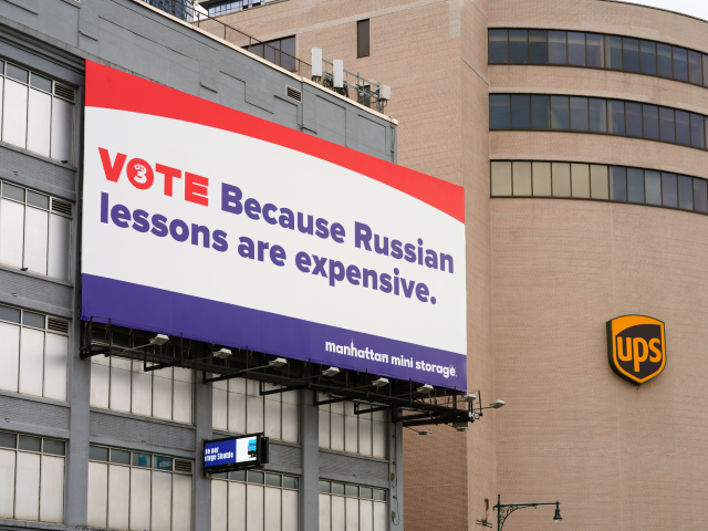27 SEP 2020- View of a political ad on a billboard saying VOTE because Russian lessons are expensive on a Manhattan Mini Storage building in Manhattan, New York.