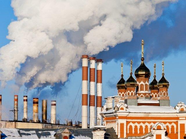 Smoking chimneys over blue sky