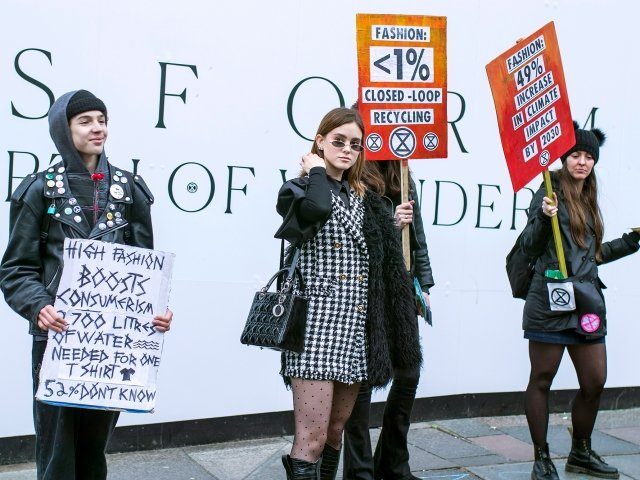 People protesting against unsustainable fast fashion in London