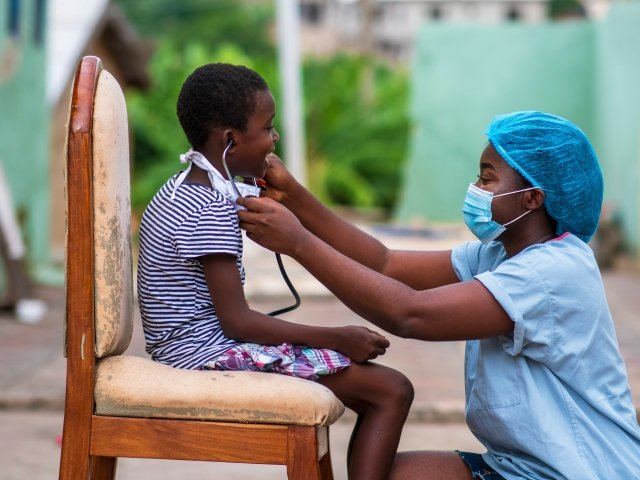 African doctor treating a child