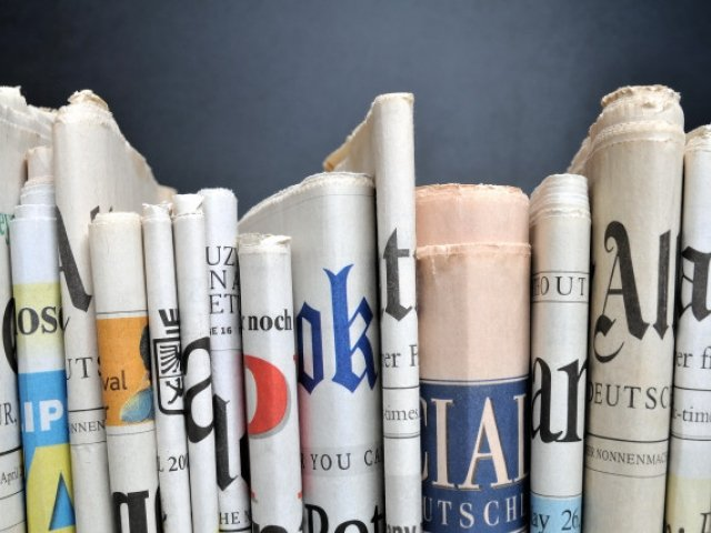 Newspapers lined up from different news outlets
