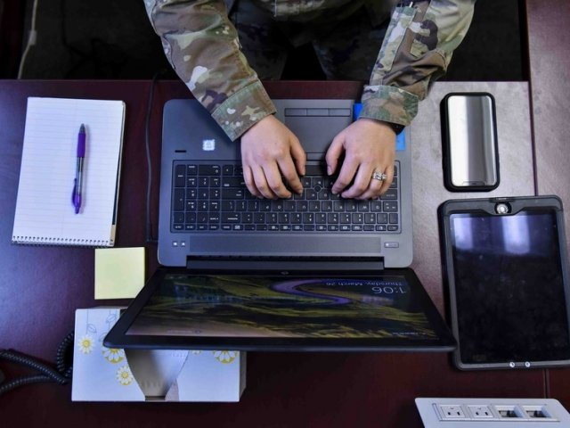 Soldier typing on computer