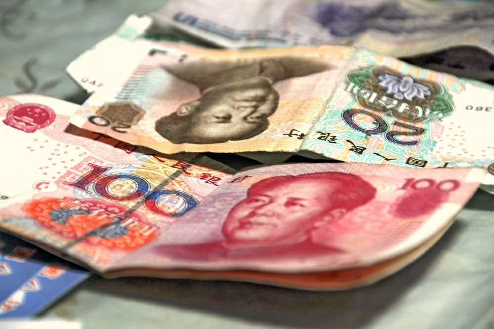 Why doesn't China directly increase RMB usage in International Trade?  (中文)