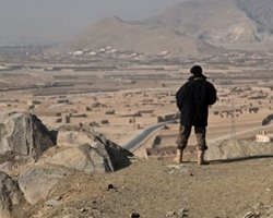 Afghan Security Guard Overlooking a Town