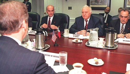Secretary of Defense William S. Cohen (left, back to camera) meets with a delegation from Georgia led by President Eduard Shevardnadze (center), and including, among others, Minister of Foreign Affairs Irakli Menagarishvili (left, facing camera), and Mr. Charkviani, head of the Foreign Relations Department, serving here as interpreter (right).
