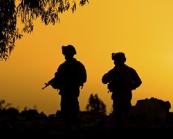 Soldiers in front of a sunset