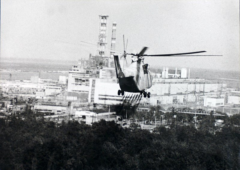 Image: A helicopter sprays a decontamination liquid nearby the Chernobyl reactor in 1986. Source: IAEA Imagebank #02790036, via Wikimedia Commons, CC BY-SA 2.0.