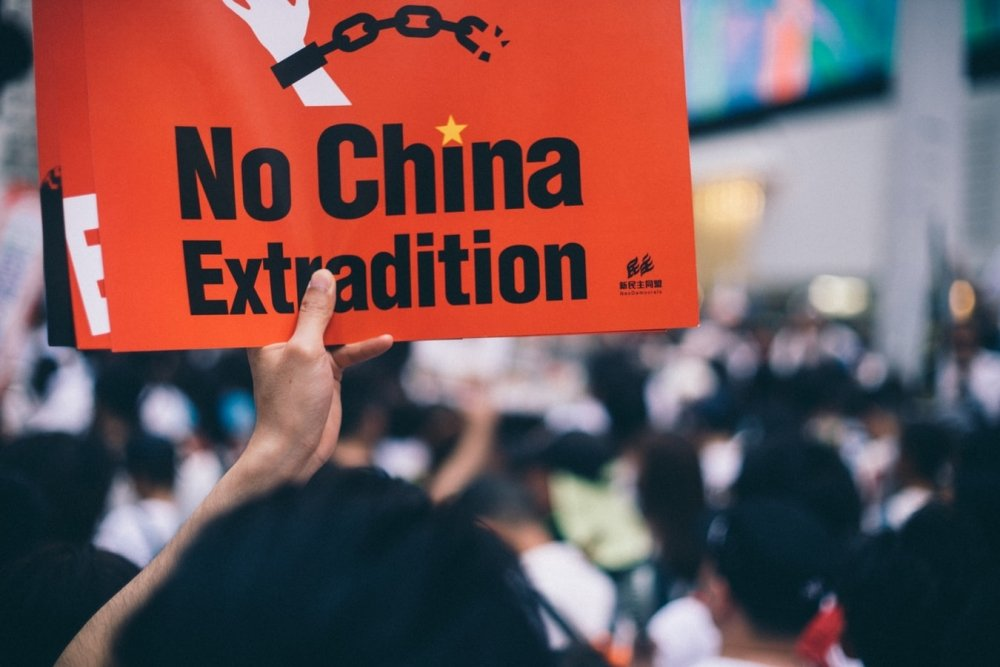 Protester holds sign in Hong Kong extradition protests. Source: Unsplash.com