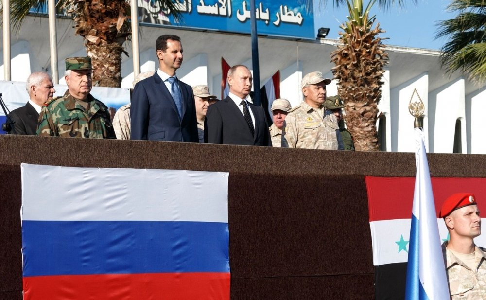 At the Khmeimim air base in Syria. With President of Syria Bashar al-Assad (left) and Defence Minister of Russia Sergei Shoigu (right). Source: Kremlin.ru