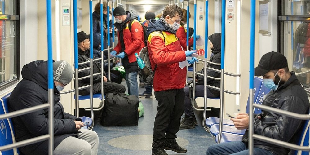 Health workers on a Moscow subway car.