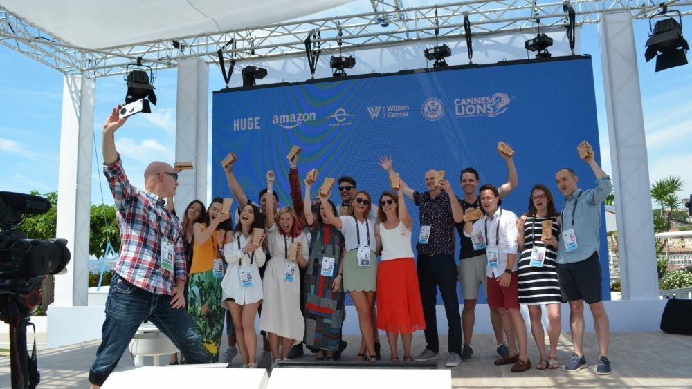 Three winning teams celebrate the results at the Cannes Hackathon.