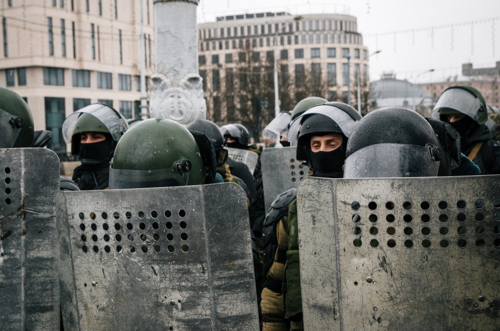 Special police unit with shields against protesters. Belarusian people participate in the protest against Lukashenko and the current authorities.