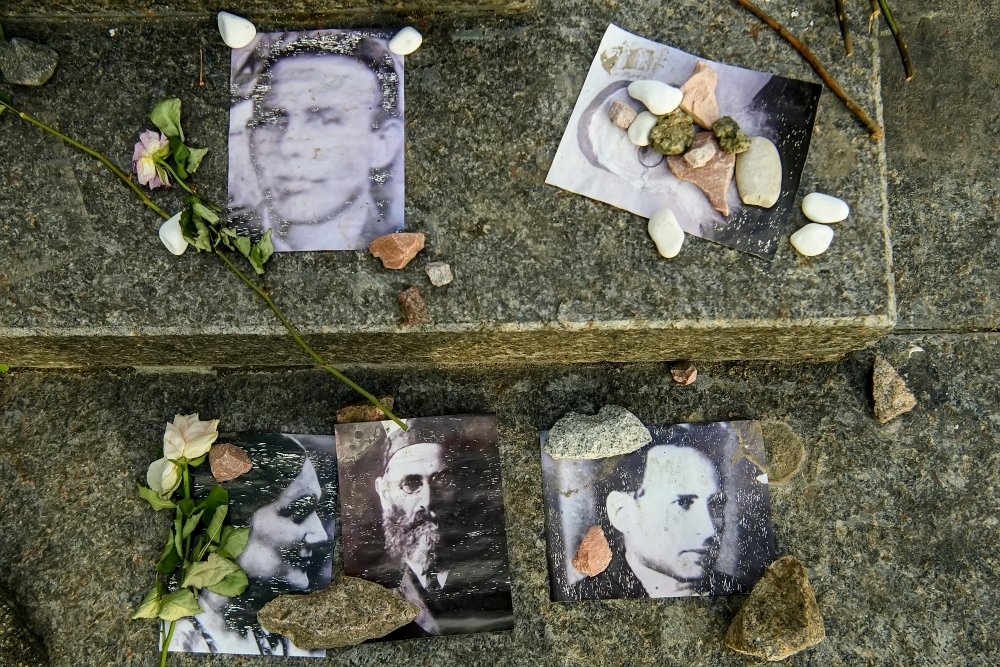 Portraits of killed Jews near Menorah monument in Memory of Jews Victims at the Babyn Yar National Historical Memorial. October 2020 Kyiv, Ukraine.