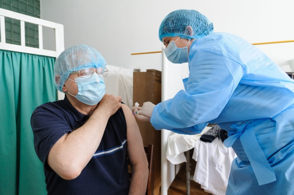 18 march 2021. Lviv, Ukraine. A health worker gets a shot of the AstraZeneca (Covishield) vaccine at the hospital. The Ministry of Health of Ukraine has publicly vaccinated health workers first