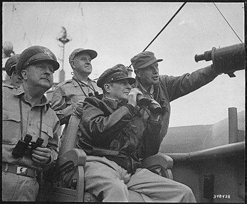 Generals Whitney, Macarthurt, and Almond observe the shelling of Inchon.