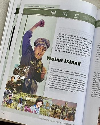 A book featuring art and stills from the film Wolmi Island