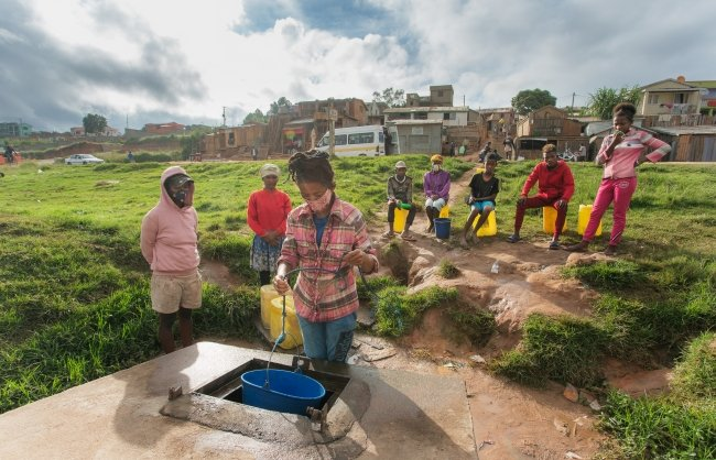 Fenosoa, like many who live in the Amoron'Akona neighborhood, works by supplying dozens of households and businesses with well water in Amoron 'Akona, Antananarivo, Madagascar