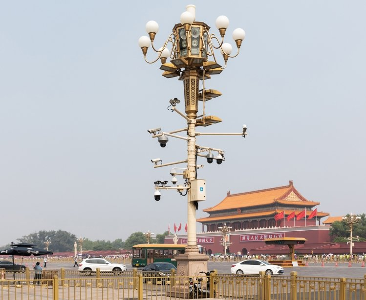A lamp post with surveillance cameras in Beijing, China.