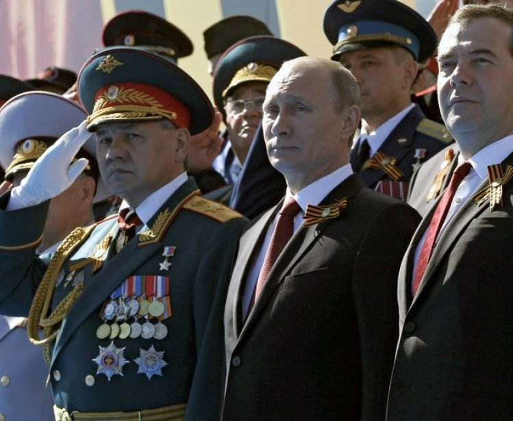 Sergey Shoigu, Vladimir Putin and Dmitry Medvedev at the military parade marking the 69th anniversary of Victory in the Great Patriotic War.