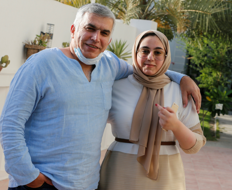 Nabeel Rajab and his daughter pose after he is freed from prison