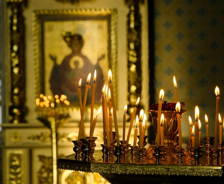 Candles are lit at an Orthodox Church
