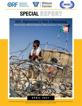 On the cover of the report is a picture of a man in a military uniform standing behind a barbed wire fence.
