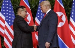 Trump Kim Summit U.S. President Donald Trump shakes hands with North Korea leader Kim Jong Un at the Capella resort on Sentosa Island Tuesday, June 12, 2018 in Singapore.