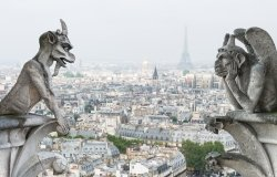 Stone gargoyle and chimera with Paris city on background. View from Notre Dame de Paris. Source: Shutterstock.