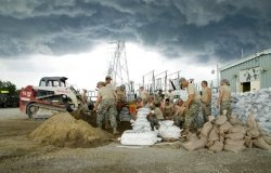 Photo Credit: Iowa National Guard members construct a levee in June 2008, courtesy of Oscar M. Sanchez-Alvarez/U.S. Air Force.