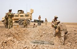 U.S. Air Force and Slovakian explosive ordnance disposal personnel unload a trailer in Afghanistan