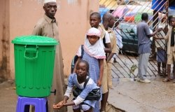 Students washing hands before entering their classroom