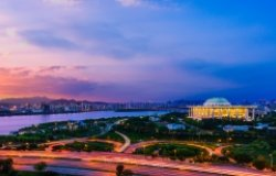 A wide shot of the city of Seoul with the National Assembly Building of South Korea in the background, shot at sunset.