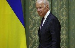Former Vice President Joe Biden next to a Ukrainian flag