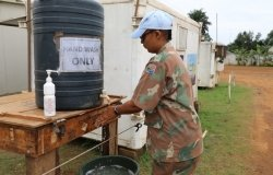 Member of the MONUSCO Force Intervention Brigade in Beni, North Kivu, DRC washing hands to ensure safety from the Covid-19 pandemic.