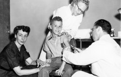 Dr. Peter Salk being injected by his father, Dr. Jonas Salk, with the experimental Polio vaccine in May 1953, when he was nine years old.