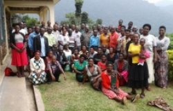 A group photo of Village Health and Conservation Teams after a training at the Gorilla Health and Community Conservation Center