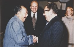 President Ford and daughter Susan watch as Secretary of State Henry Kissinger shakes hands with Mao Tse-Tung; Chairman of Chinese Communist Party, during a visit to the Chairman's residence.