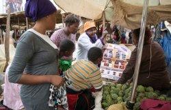 woman explain cervical cancer in market