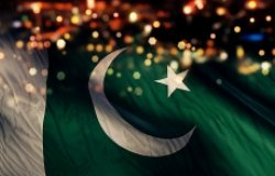 A Pakistani flag on a background of lights