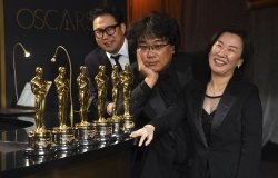 Han Jin Won, from left, Bong Joon-ho, and Kwak Sin Ae at the Oscars