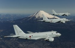 Three JMSDF planes in flight with Mount Fuji in the background.