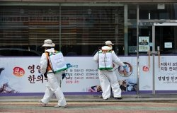 Volunteers from Pohang City are conducting COVID-19 disinfection on the morning of March 15, 2020, in Ocheon-eup, Pohang-si, North Gyeongsang Province, South Korea.
