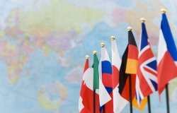 Flags of the G7 countries in front of a world map.