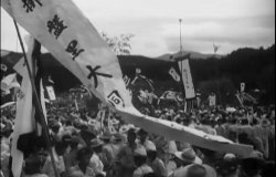 A banner with Korean text flies during a celebration.
