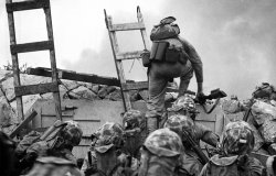 A soldier climbs over the seawall during the Inchon Landing in 1950.